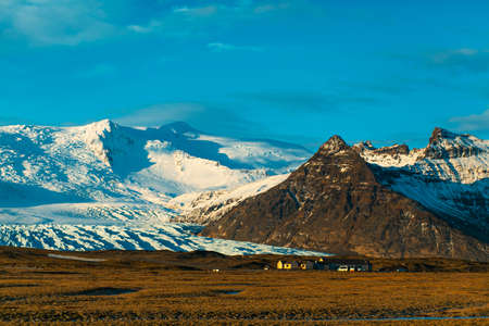 Incredible Icelandic landscapes. Snow-capped mountains and glacier. Sunset Stock fotó
