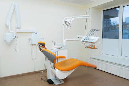 Interior stylish modern dentist office in orange style