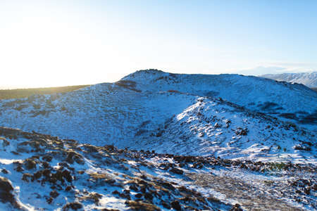 Iceland's incredible mountain landscape in winter. Mountains in the snow. Large spaces. The beauty of winter nature.