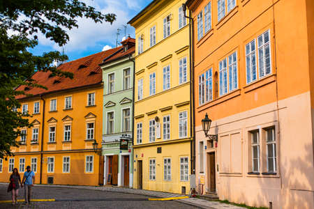 The architecture of the strago city of Prague. Multi-colored low buildings and stone paving stones. Streets of old Europe.