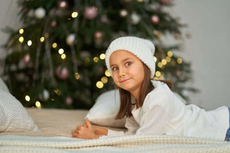 Happy childhood, Christmas magic fairy tale. Little girl waiting for Christmas and holiday gifts
