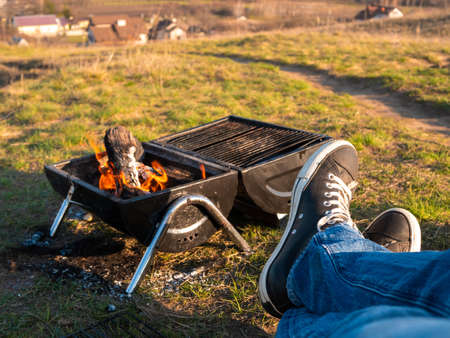 Having a good time barbecuing outdoors on a hike.