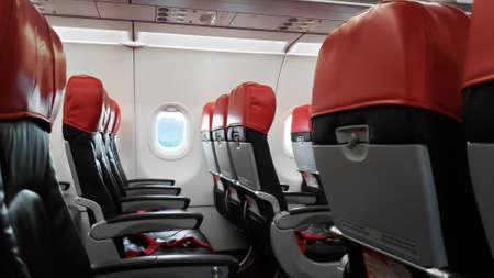 Deserted aircraft interior, empty passenger seats. Stock Photo