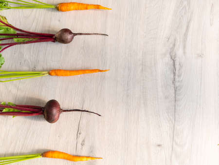 Fresh beautiful washed beets and carrots. layout, top view.