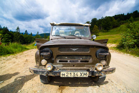 Jeeping mountain car travel. Highlands scenery. Editorial