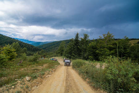 Jeep mountain car travel. Highlands scenery. Editorial