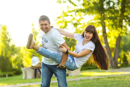 Young romantic couple have fun enjoy each other in green summer park. Foto de archivo