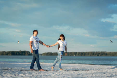 Young couple romantic date at sand beach. Editorial