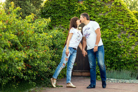Young romantic couple have fun enjoy each other in green summer park. Editorial