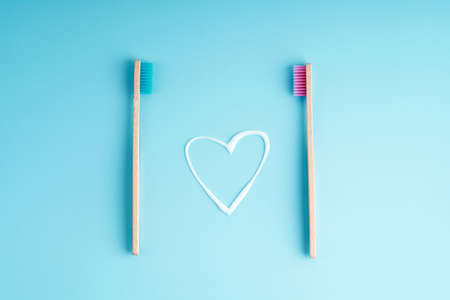 A pair of eco-friendly bamboo toothbrushes. Global environmental trends. Toothbrushes of different genders.
