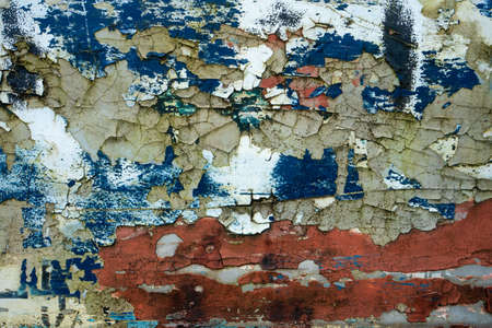 Texture of old concrete wall with many peeled paint layers.