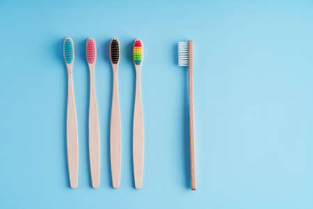A bunch of eco-friendly bamboo toothbrushes. Global environmental trends. Gender and racial inequality. toothbrushes of different genders. 写真素材