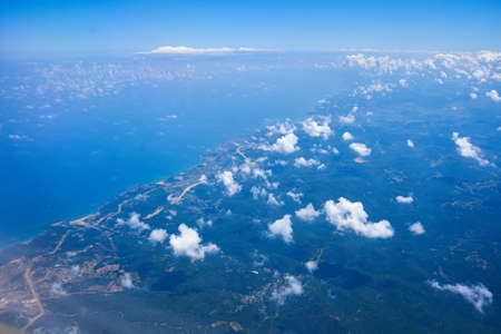 Daytime view from a flying plane at high altitude.