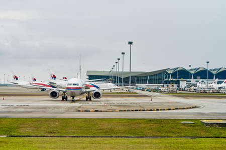 Langkawi island airport. View of the aircraft parking from the runway. Langkawi, Malaysia - 06.20. 新闻类图片