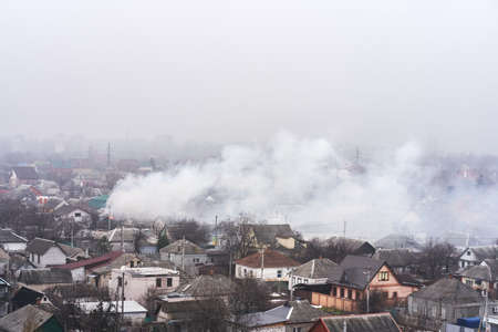 Top view of the area in which a residential building is on fire. Fire in the private housing sector.