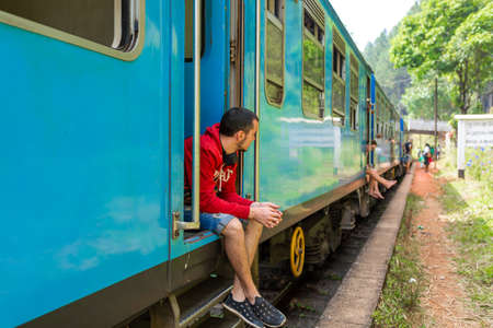 Travel by train in Sri Lanka. A very slow train with no doors. Picturesque places of the island.