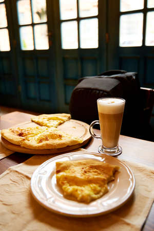 Lunch at a cafe. Khachapuri and latte.