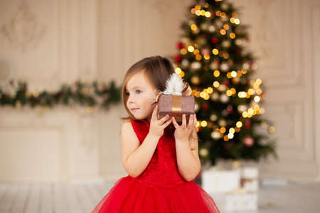The child is exited and ready to celebrate Christmas.