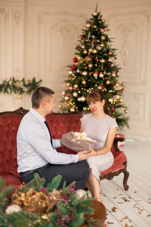Happy couple in love together spend Christmas holidays together.