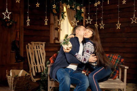 Young couple in love spend Christmas night together enjoying each other.