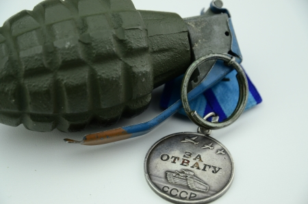 medal and grenade