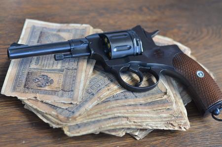 savety: gun and cash