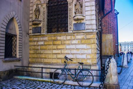 marys: Bicycle near St. Mary`s Basilica, Krakow, Poland Stock Photo