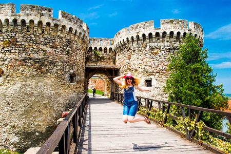 Girl jumping near Belgrade Serbia Castle Stock Photo