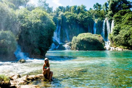 Girl near Kravice Waterfall Bosnia Stock Photo