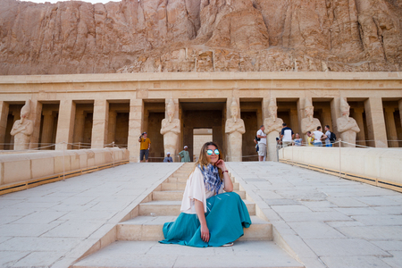 The girl near the ancient temple in Luxor, Egypt