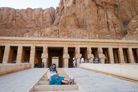 The girl on the steps of temple in Luxor, Egypt
