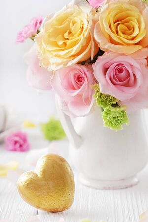 colorful flowers in a vase and heart. bouquet for birthday, wedding, mothers day, valentines day or another occasion