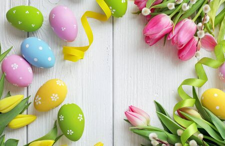 frame with border with colorful easter eggs and spring flowers