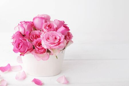 pink rose flowers in a vase. shabby chic colors Stock Photo