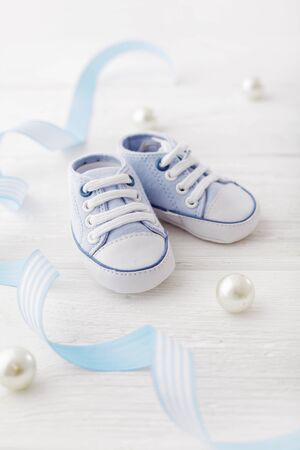 close-up of baby shoes. Baby birth accessories.