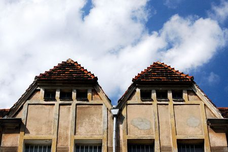 deformity:  Interesting double roof on beautiful blue sky Stock Photo
