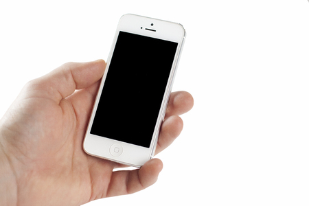 iphone5: Mobile phone iPhone 5 in the hand on the white background