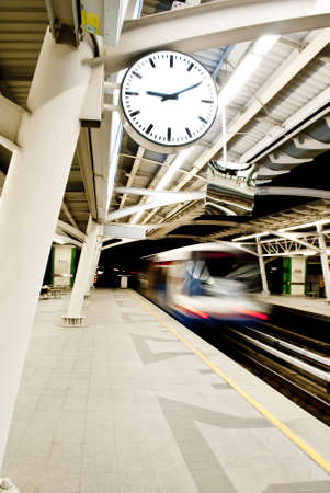 subway platform: Sky train station with vintage clock Stock Photo