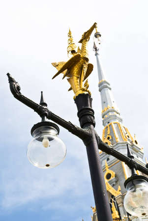 Gold Bird Statue on the pole   photo
