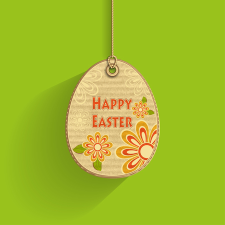 corrugated cardboard: Egg on cord with corrugated cardboard texture and flowers on green background frame of celebration Easter