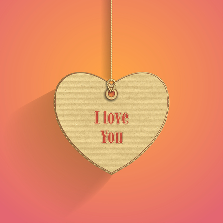 corrugated cardboard: Heart on cord with corrugated cardboard texture on pink background for frame of Valentines Day or confession of love