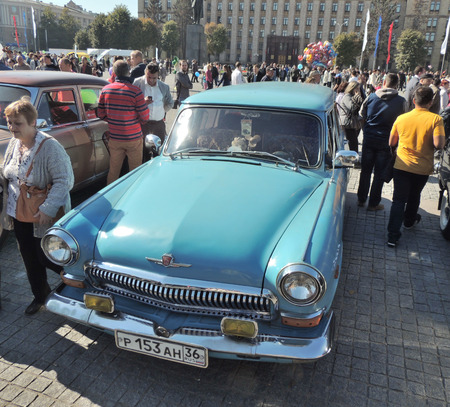 station wagon: Retro car station wagon Volga GAZ-21 the city street on the City Day Editorial