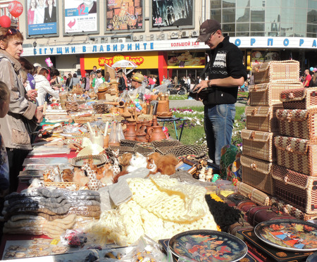 street vendor: street vendor and buyers near street stall with souvenirs and another handicraft goods