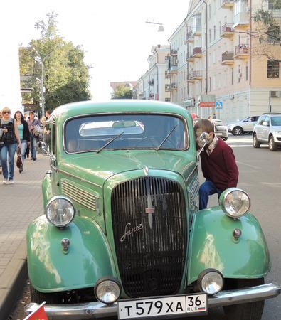 preadolescent: Pre-adolescent child take a good look inside of the retro car Opel Super