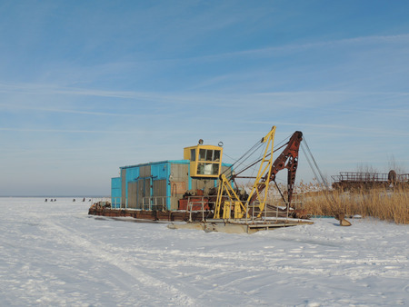 suction: river suction dredge at winter