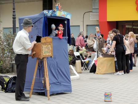 puppet show: Street presenter with hurdy-gurdy and his puppet show