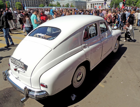ve: City dweller around soviet retro executive car of 1950s sedan fastback GAZM20 Pobeda Victory at the VE Day