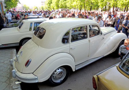 outside machines: Profile and rear part of East Germany retro car of 1950s BMW EMW 340 340