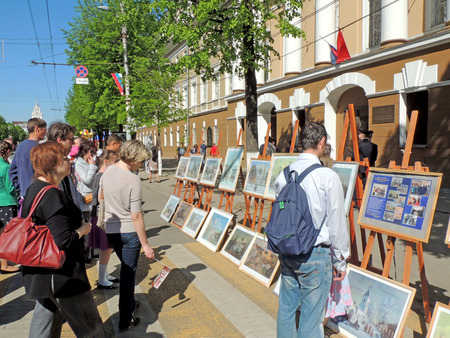 City dwellers looking paintings on the street art exhibition in the city core on celebration of Victory VE Day Editorial