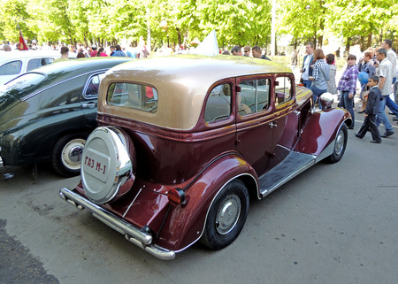 zinnwaldite brown: Side and back elevation of Soviet retro frontengine rearwheeldrive passenger car of 193040s sedan GAZ M1 Emka